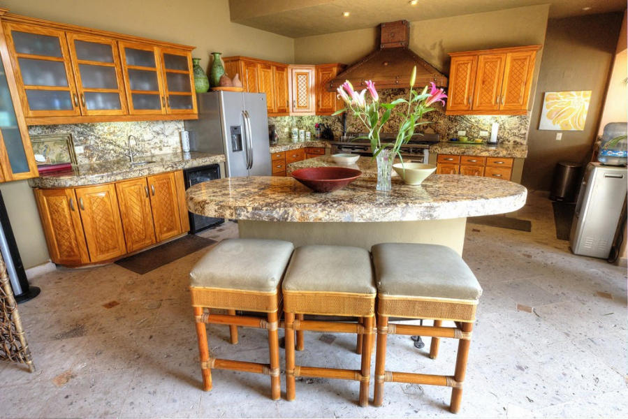 Villa Suzannah offers beautiful granite counters and natural hardwood carpentry