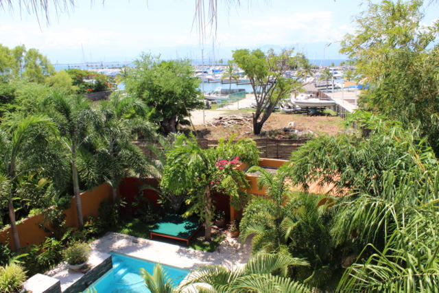Casa Jemi has a courtyard with three one bedroom and one bathroom apartments plus a retail space.