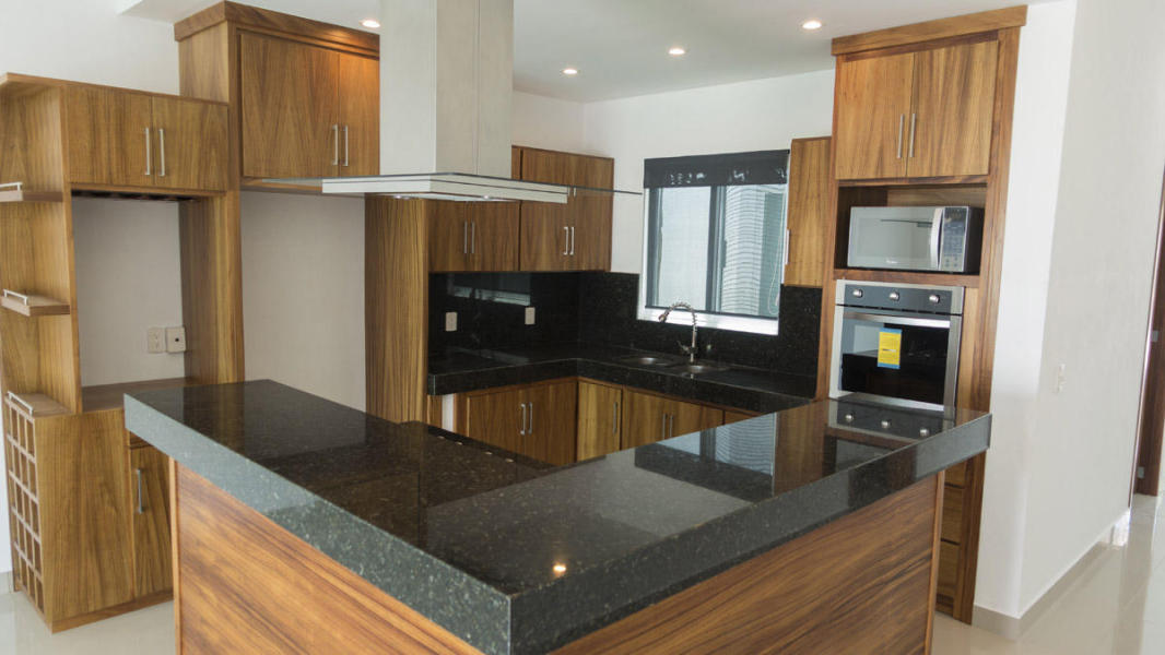 Casa Primavera. Open granite kitchen with lots of cupboards, big laundry room and lots of built-in closets and storage throughout.
