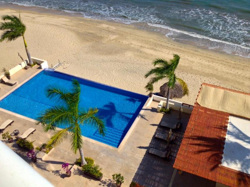 Immaculate beachfront 3 bed. condo below-market price. With a coveted location on a beautiful stretch of wide sandy beach an easy walk from the pulse of the Bucerias town plaza.