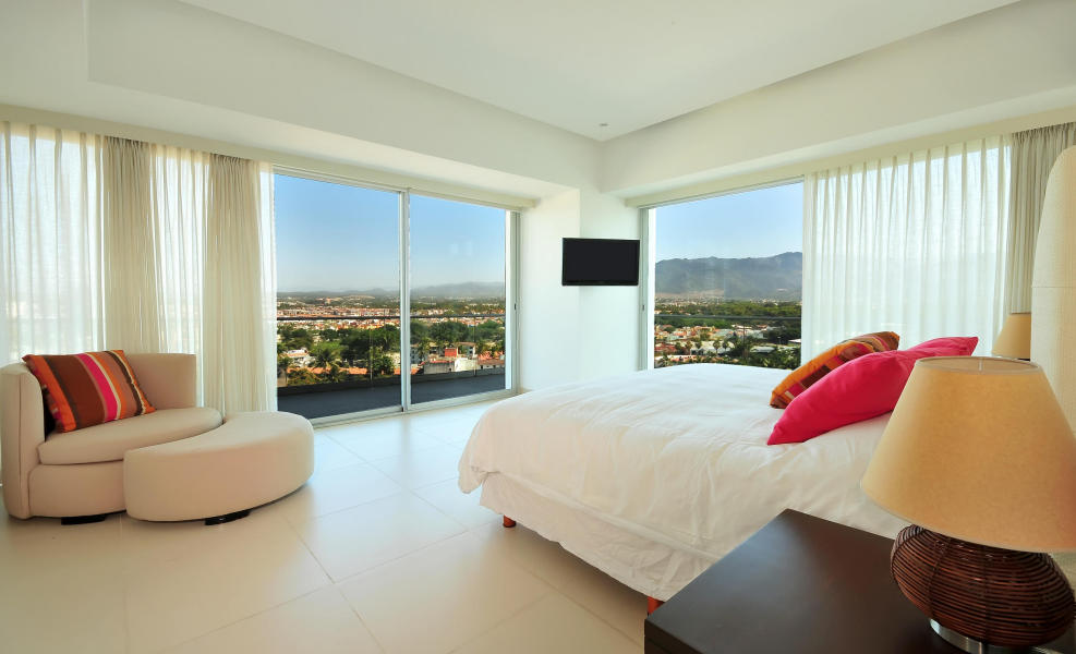 3 Bedroom/3 bath condo has a King bed in the Master suite, which opens onto the wrap around balcony, with views to the Banderas Bay.