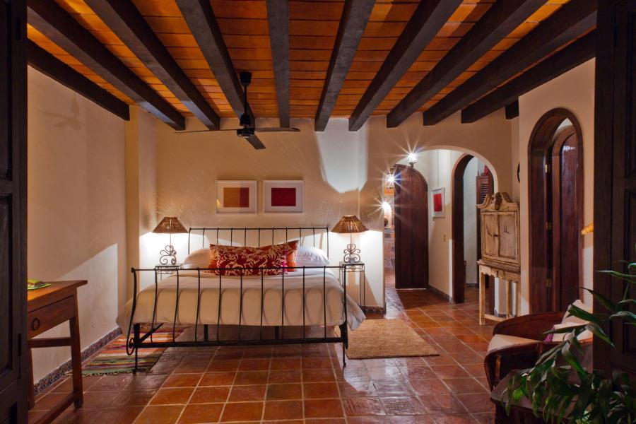 hree levels of colonial style hacienda are equipped with five bedrooms, each with spectacular views of the bay from their terraces