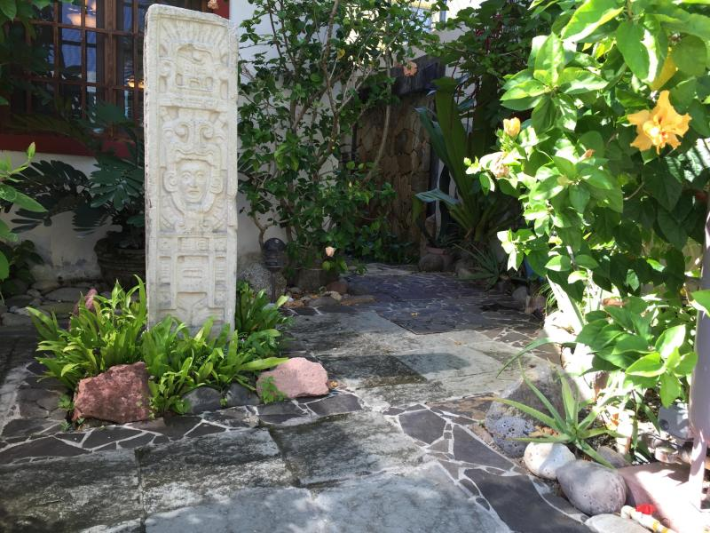 Enjoy a 3 tiered water fountain, lush tropical plants and a stone waterfall wall.