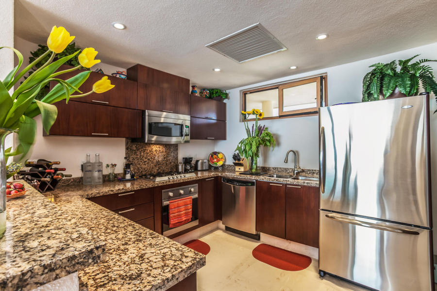 Condo features a large integrated living /dining with granite kitchen and eating bar.