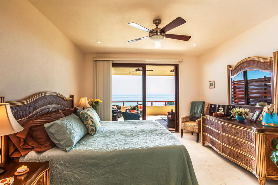 Bedrooms have a split plan both facing the ocean for those cool breezes and sunrise views.